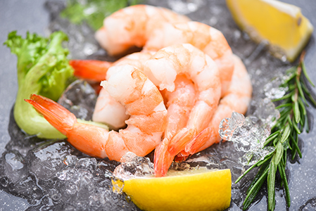 Boiled shrimps prawns on ice frozen at the seafood restaurant -