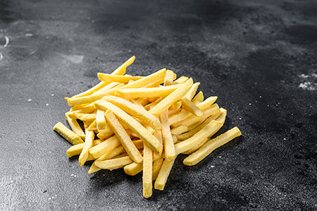 Frozen potatoes, French fries, canned food. Black background. To