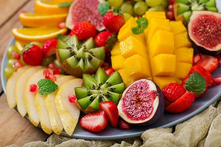 Platter fruits and berries. Mango, kiwi, fig, strawberry, grapes
